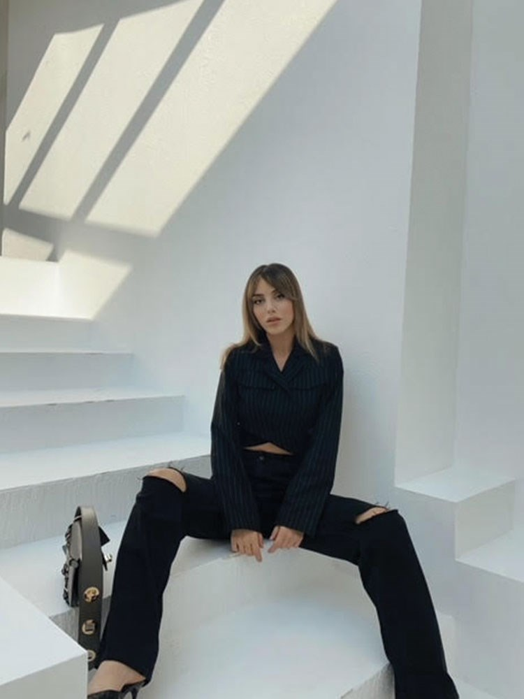 a person sitting on a staircase