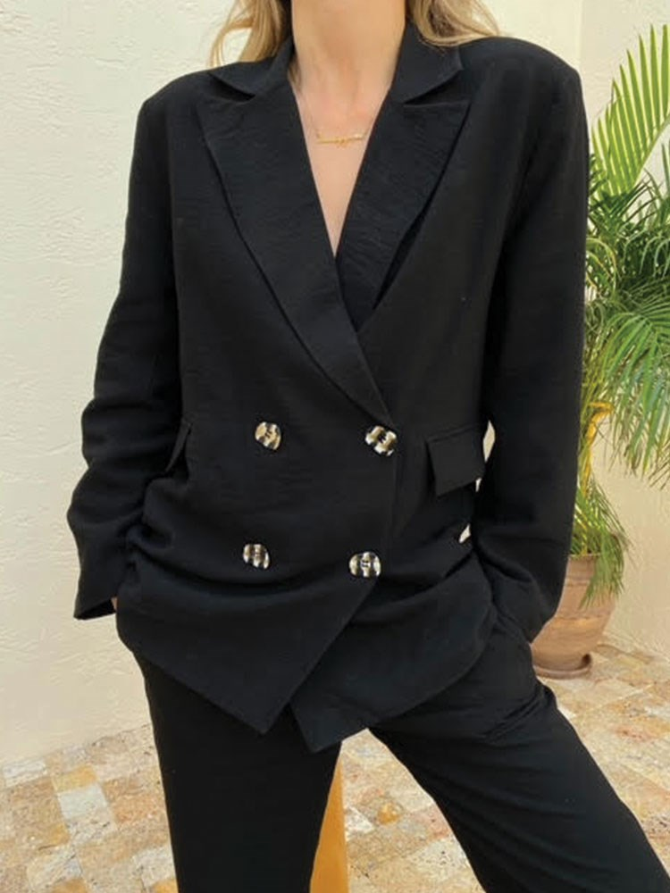 a person wearing a black jacket