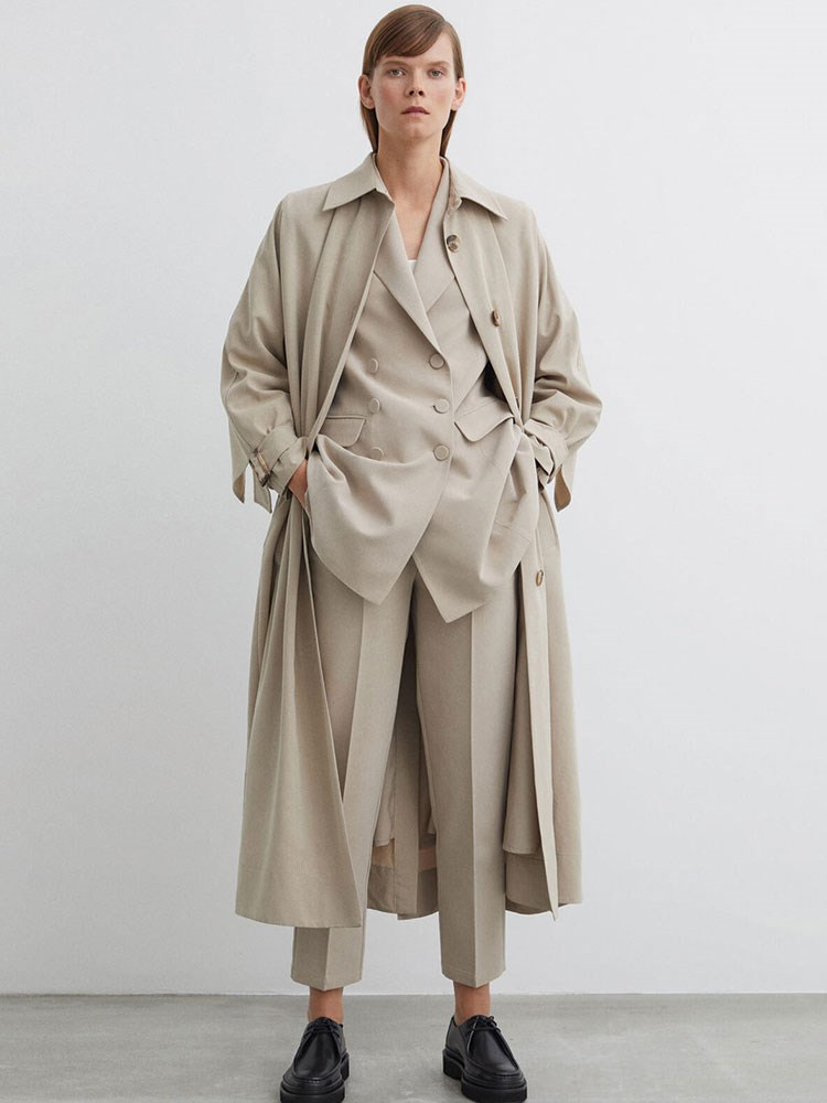 a person wearing a long coat