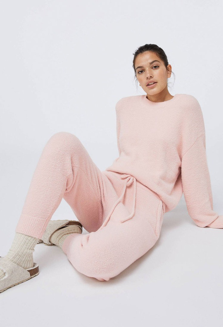 a person in pink sitting on the floor