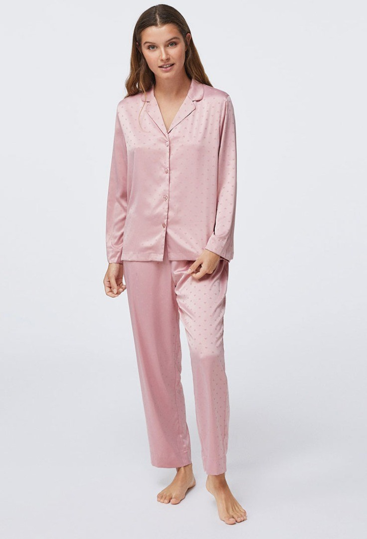 a woman wearing a pink suit