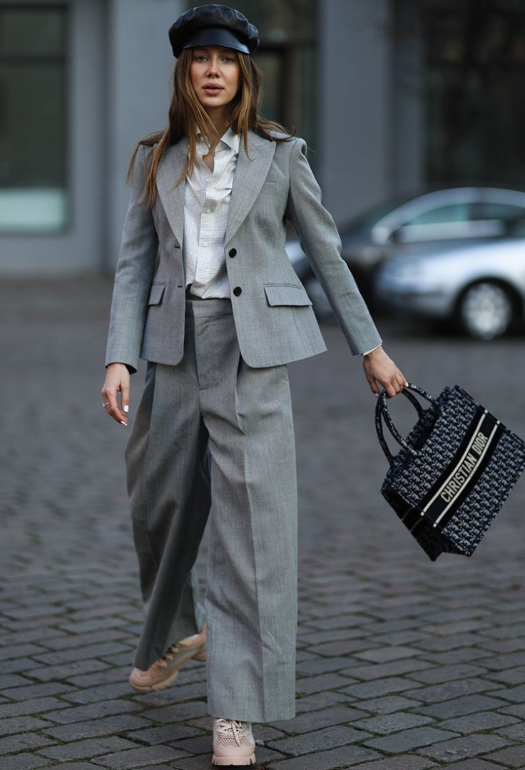 a person in a grey suit