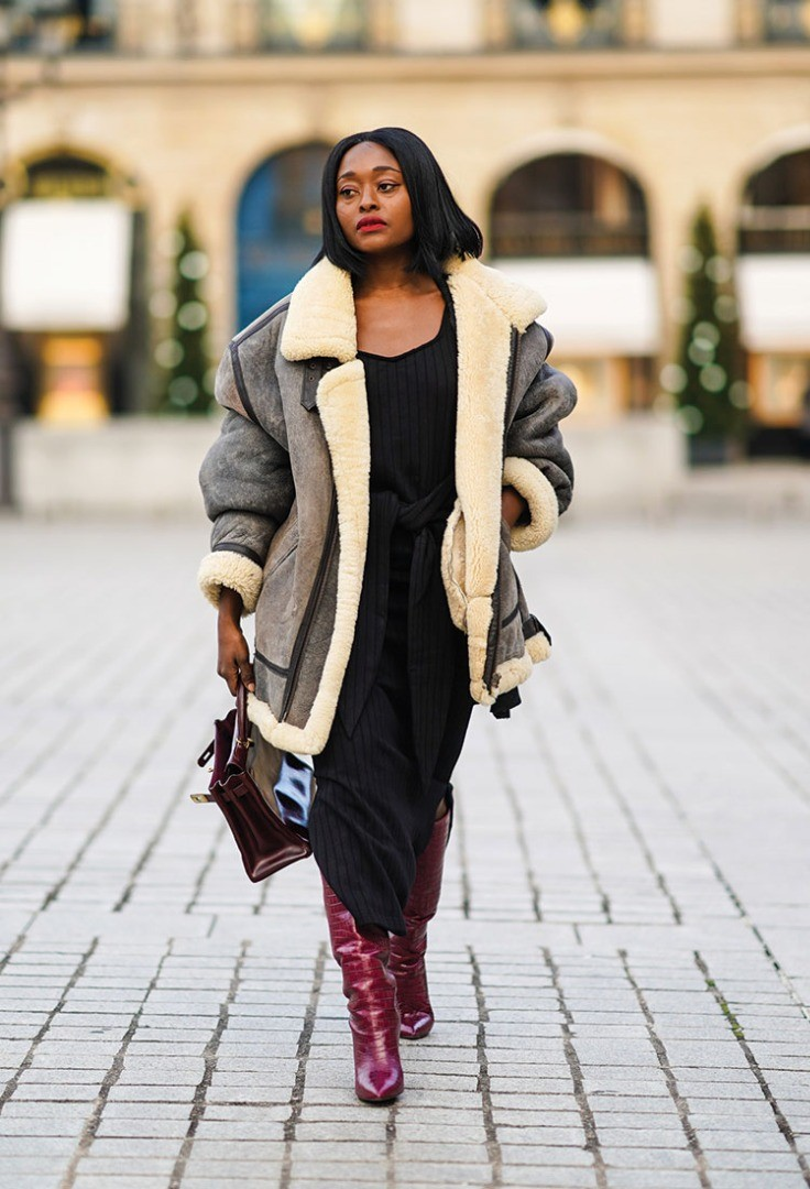 a person wearing a coat and boots