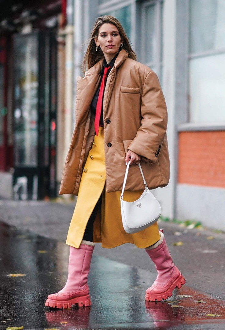 a woman in a coat and boots