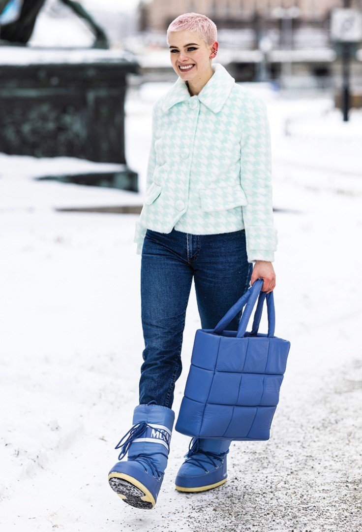a person holding a blue bag