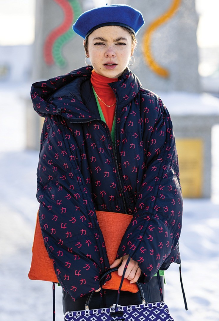 a person wearing a colorful coat
