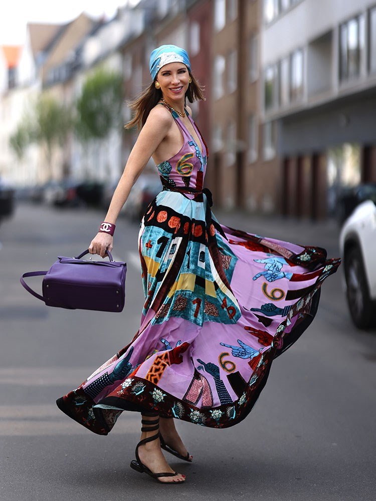 a woman in a colorful dress