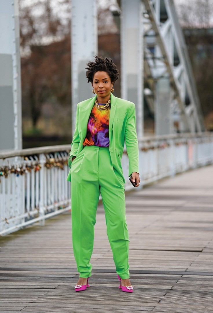 a person in a green suit
