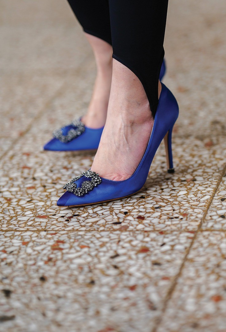 a person wearing blue shoes