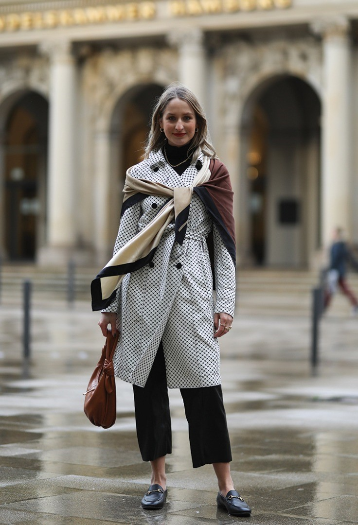 a woman in a scarf and coat