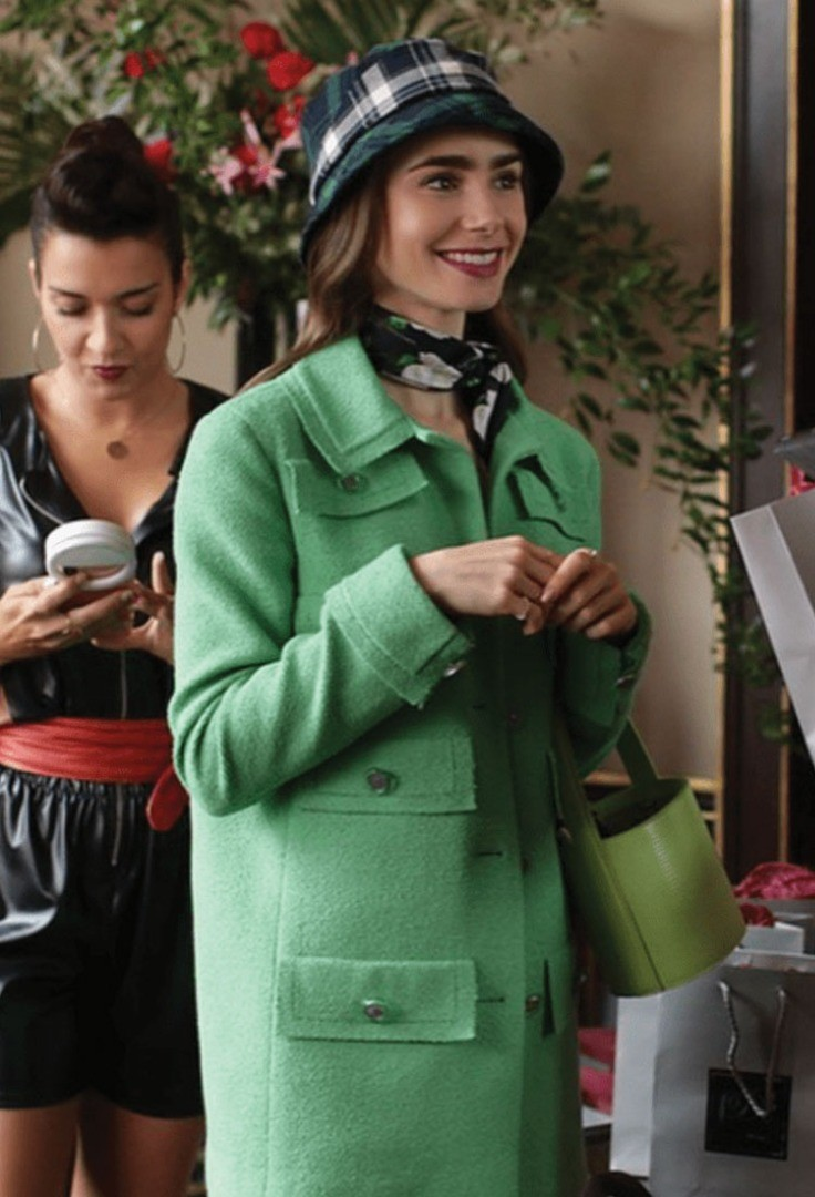 Lily Collins in a green coat