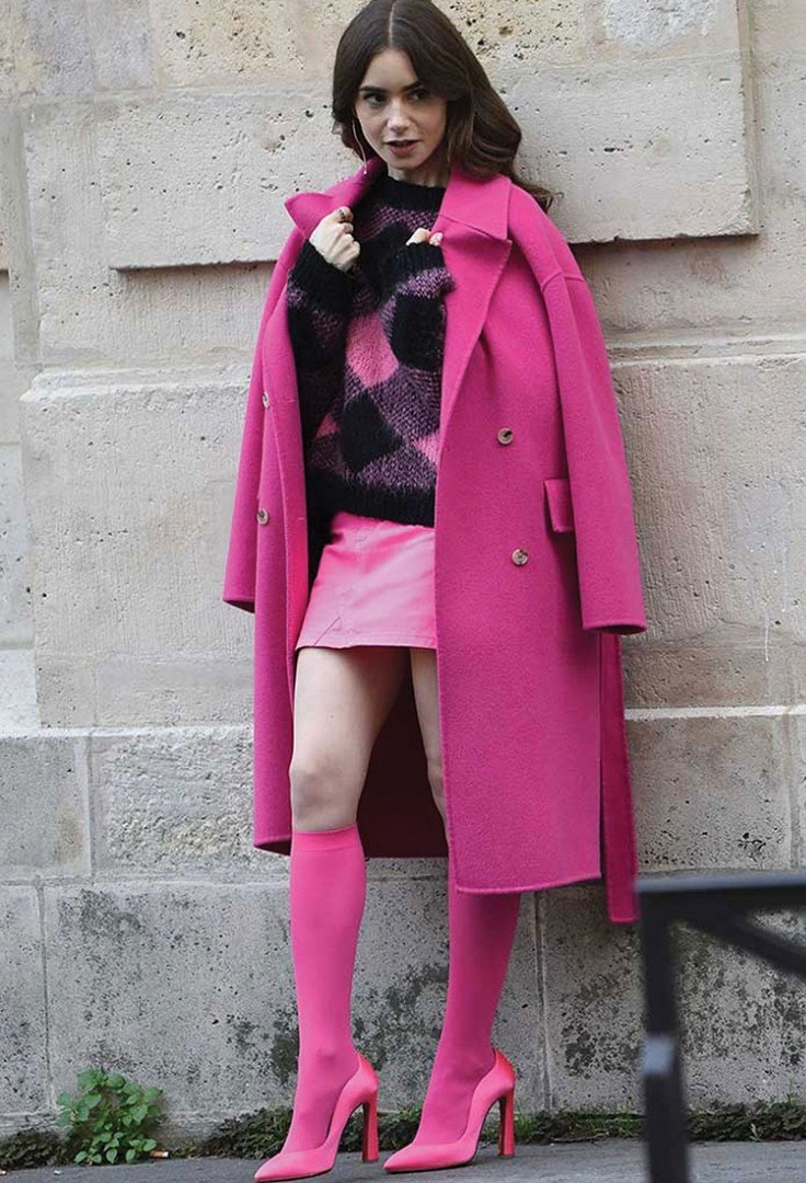 Lily Collins in a pink coat
