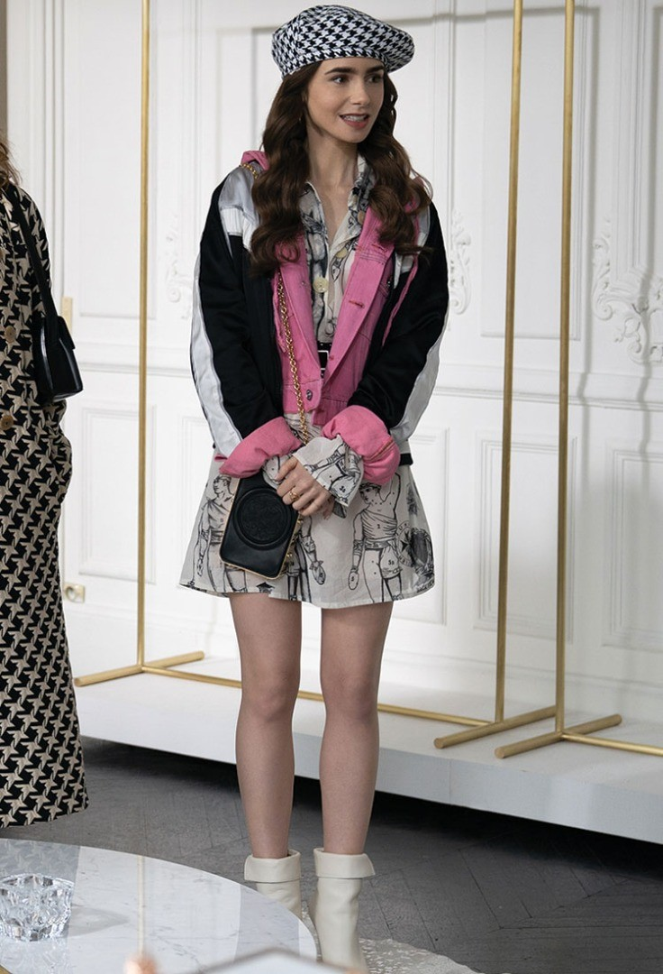 Lily Collins wearing a hat and a coat