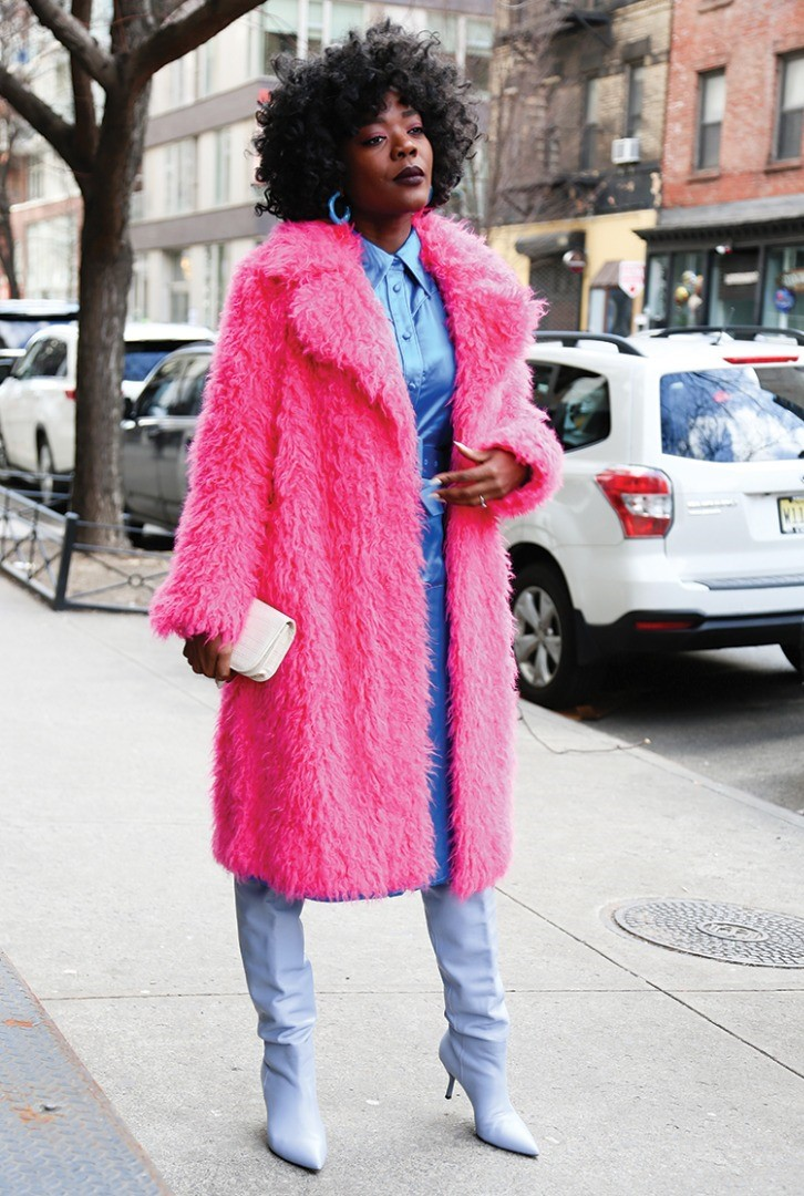 a woman in a pink coat