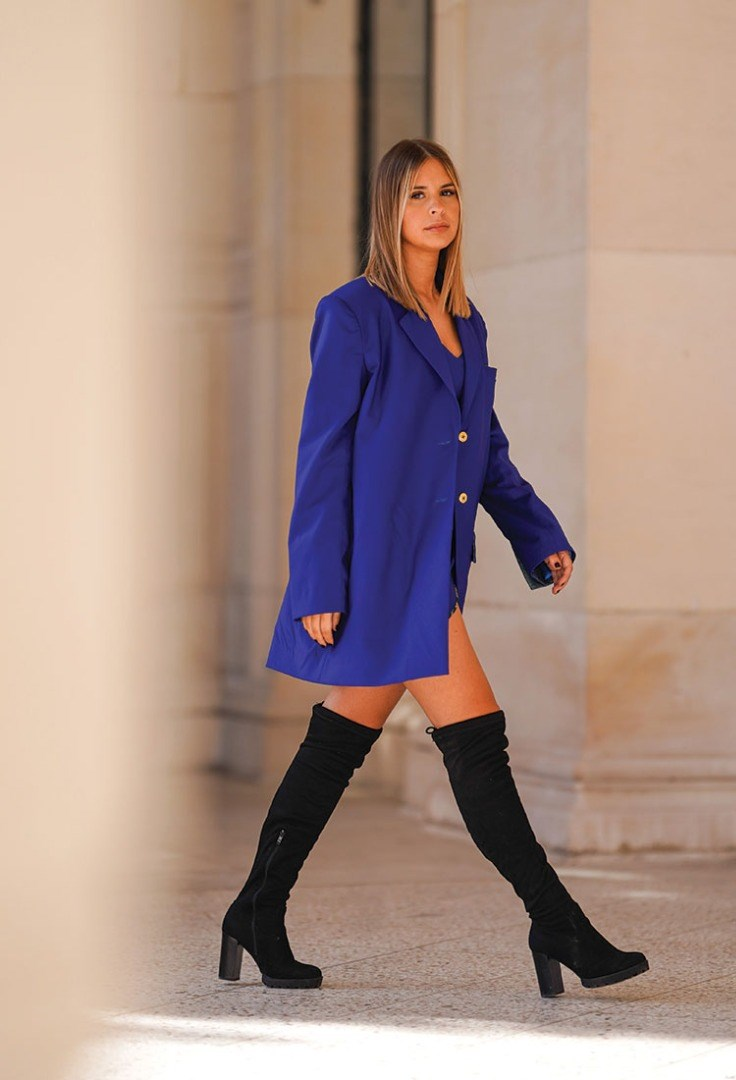 a person in a blue coat