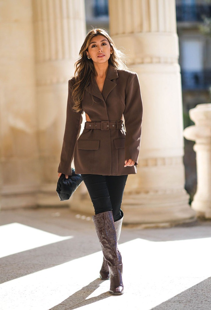 a woman in a brown coat