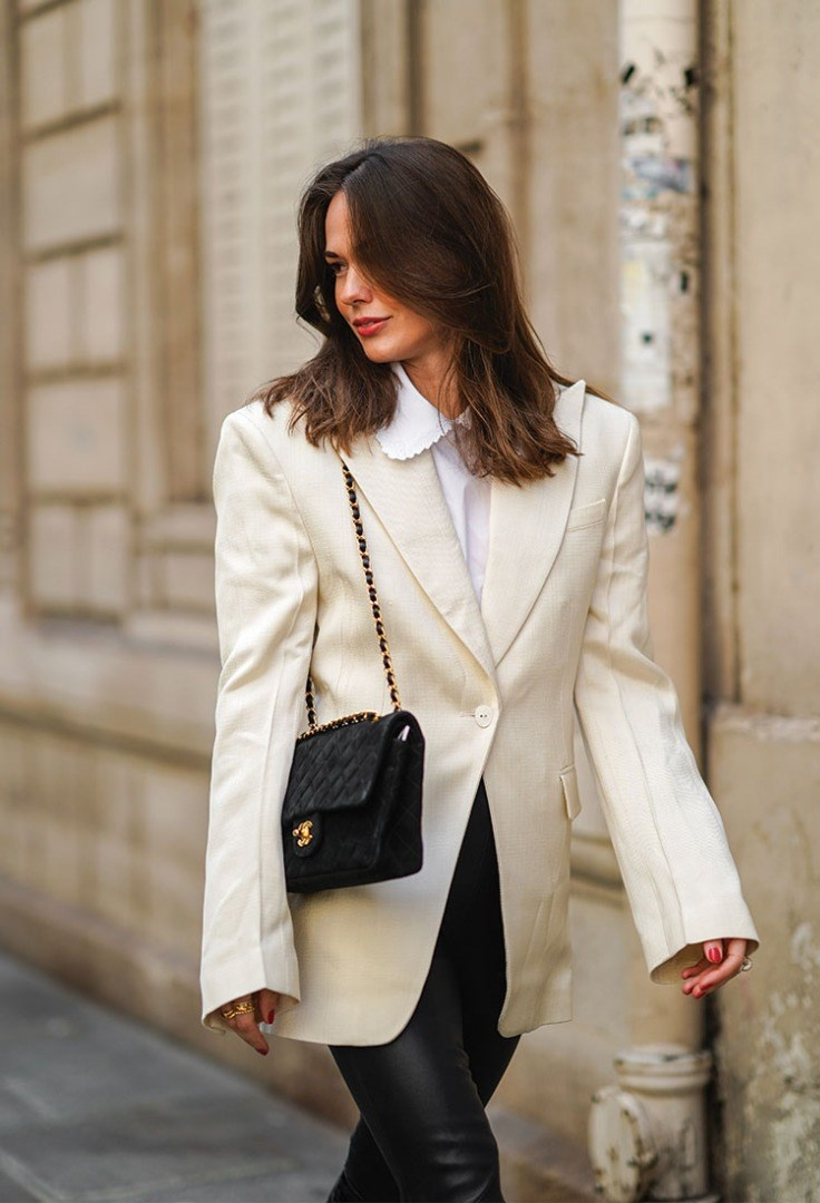 a woman in a white coat