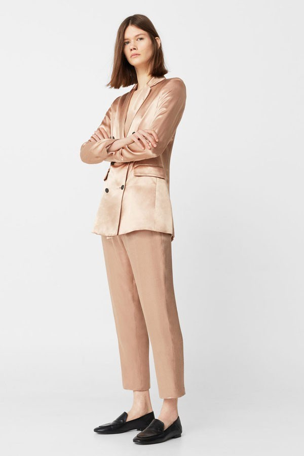 a woman in a brown suit
