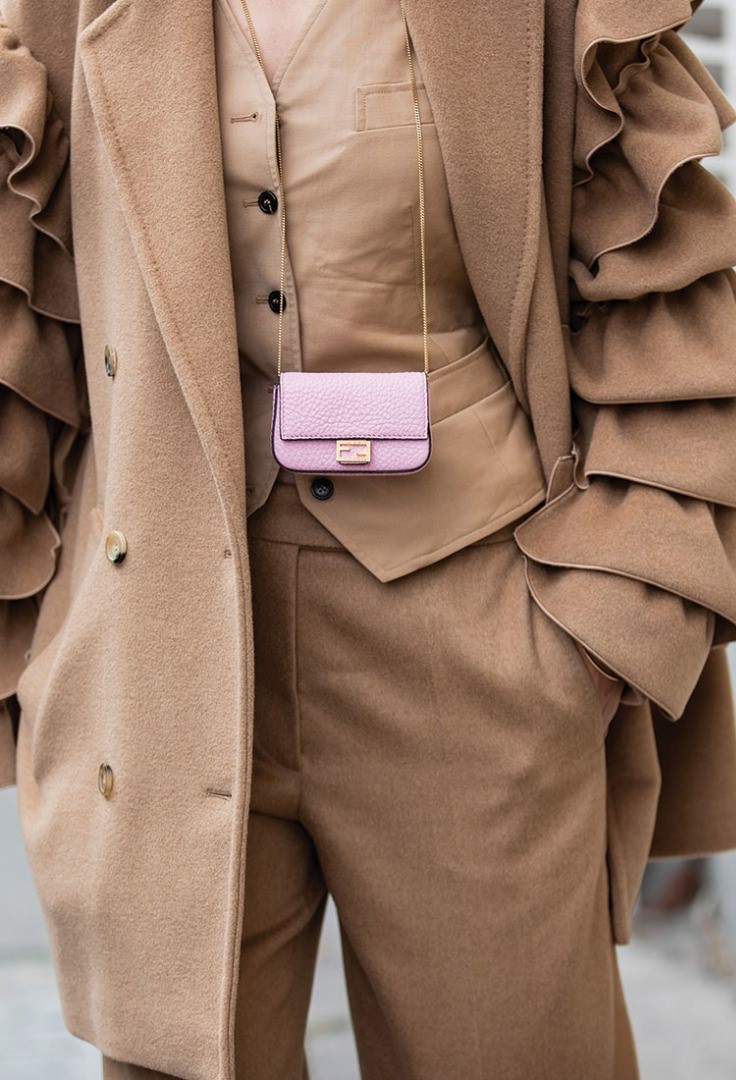 a brown trench coat with a tag