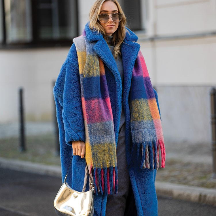 a woman wearing a colorful scarf
