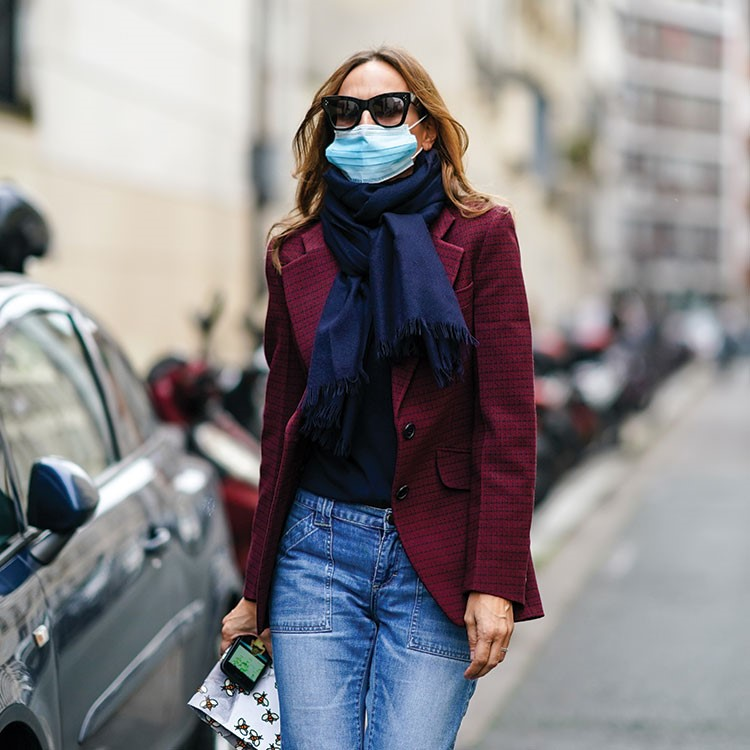 a woman wearing sunglasses and a scarf