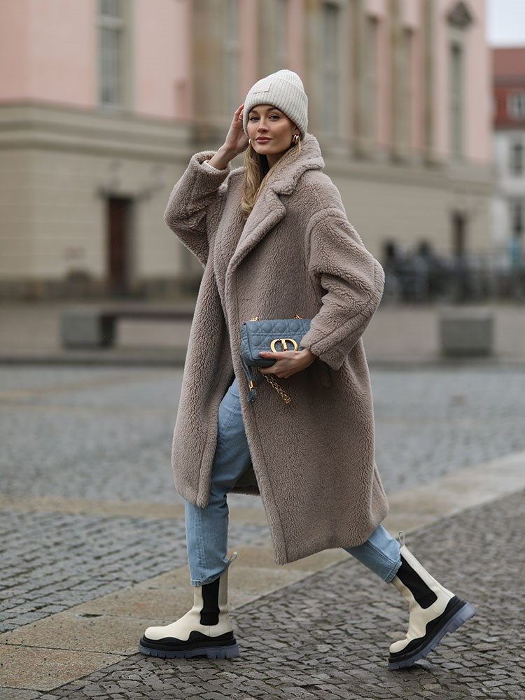a person wearing a coat and hat