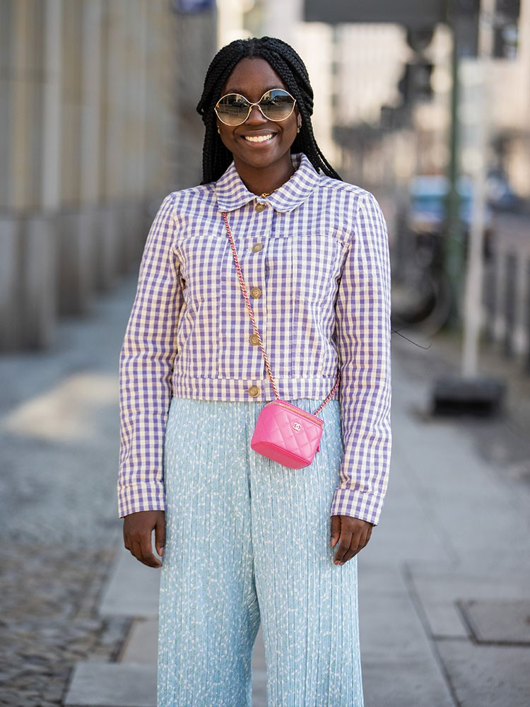 a person wearing a plaid shirt and sunglasses