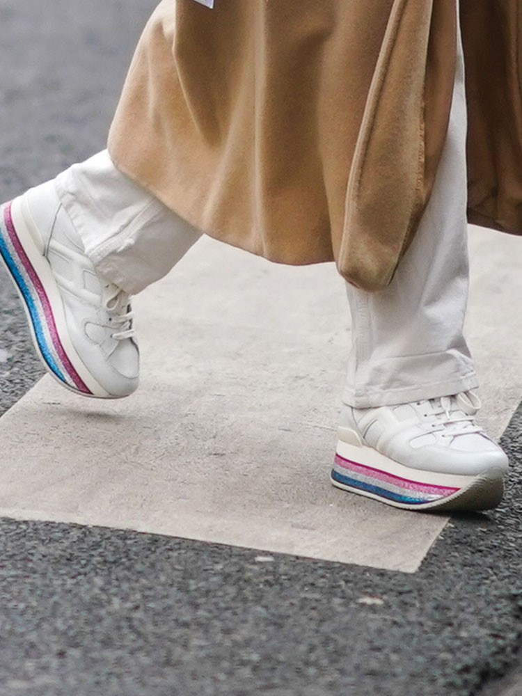 a person's legs and shoes
