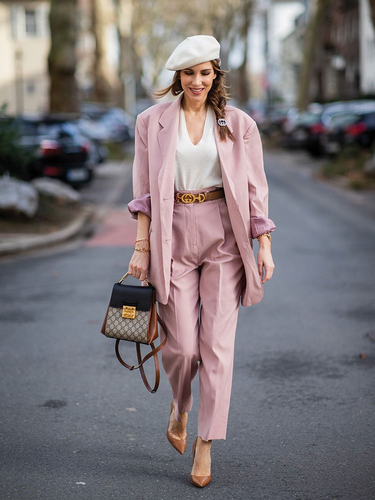 a woman in a pink suit