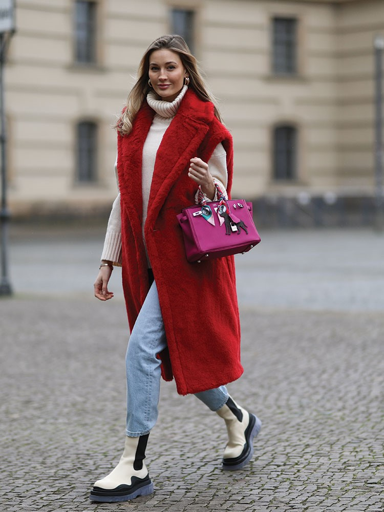 a woman in a red coat