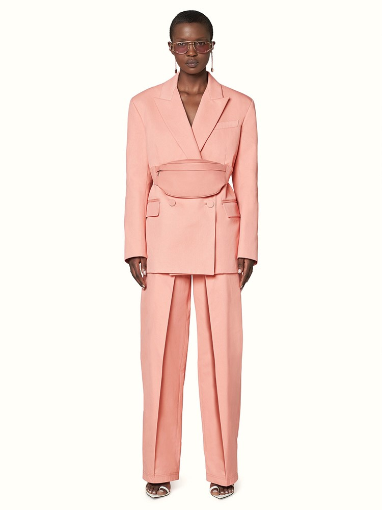 a person wearing a pink suit