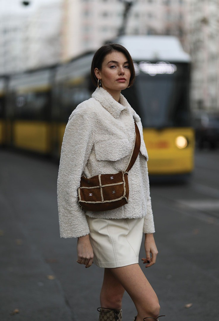 a person in a grey coat
