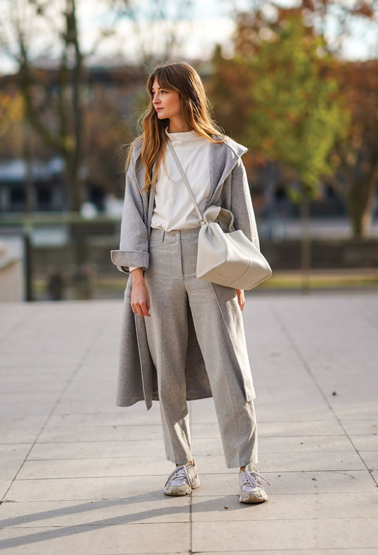 a woman in a grey suit