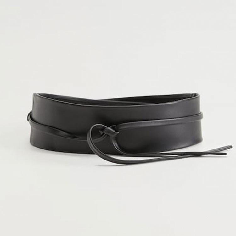 a black shoe with a strap