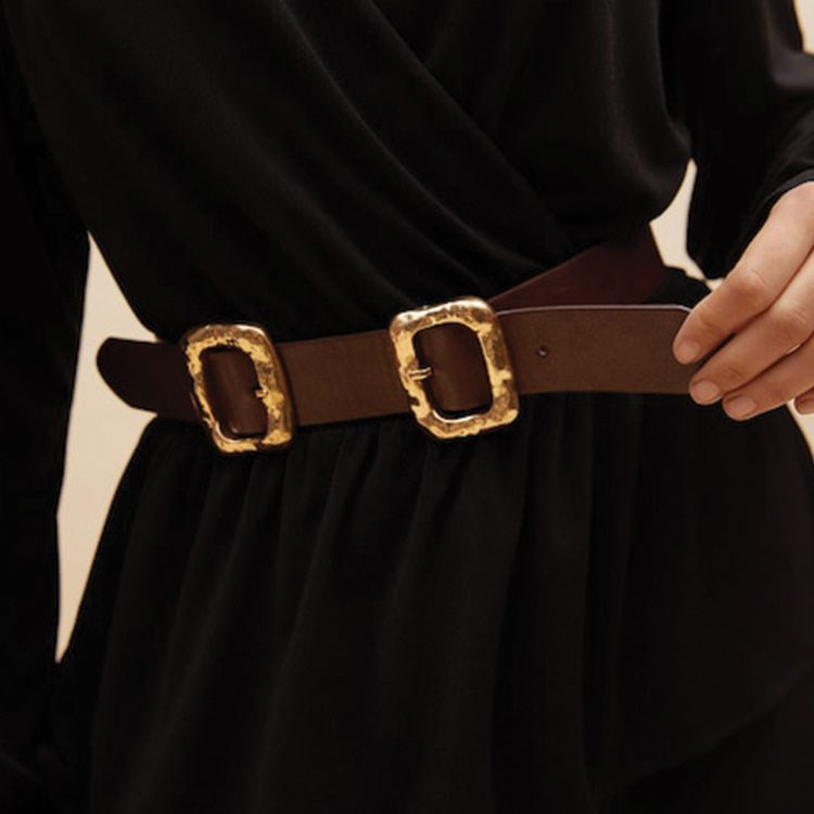 a person holding a belt
