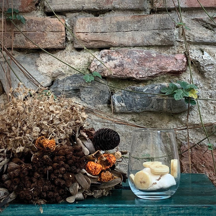 a stone wall with a stone wall and a stone walkway with a bowl of food and a bowl