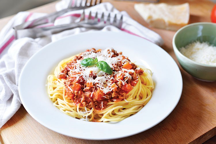a plate of spaghetti and sauce