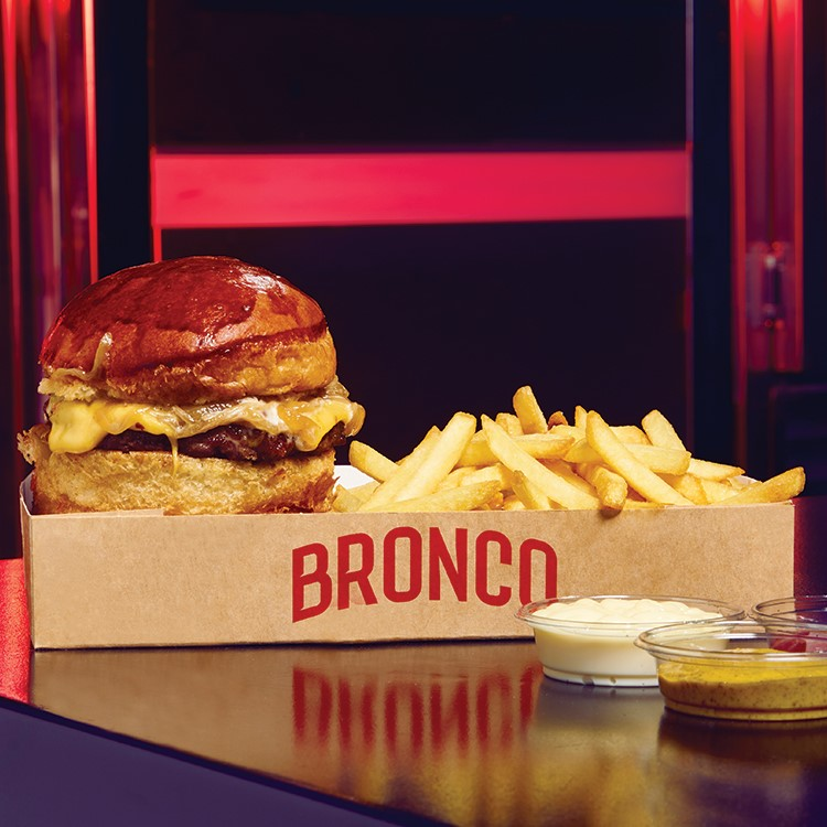 a burger and fries in a box