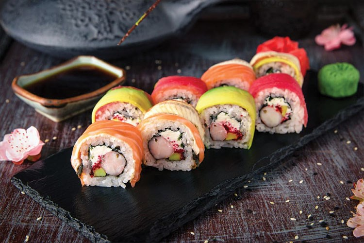 a group of sushi rolls