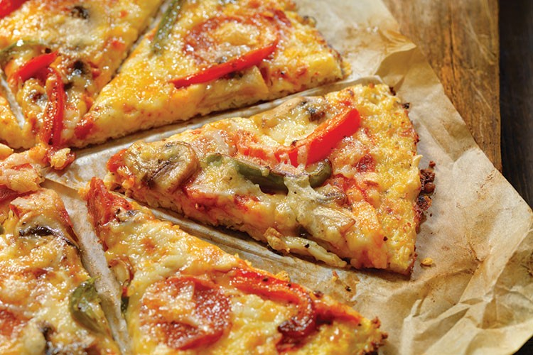 a pizza with cheese and tomatoes