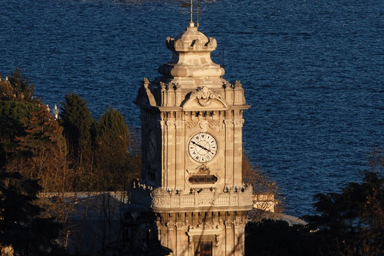 a clock tower with a weather vane