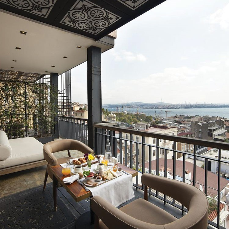 a table with food on it on a balcony overlooking a city