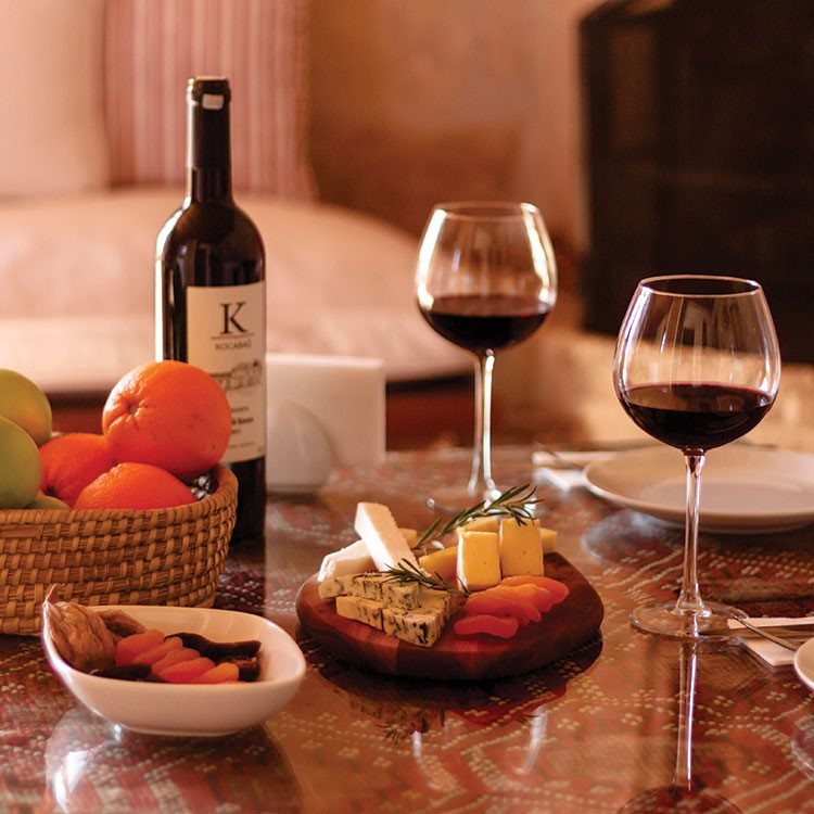 a table with wine glasses and food