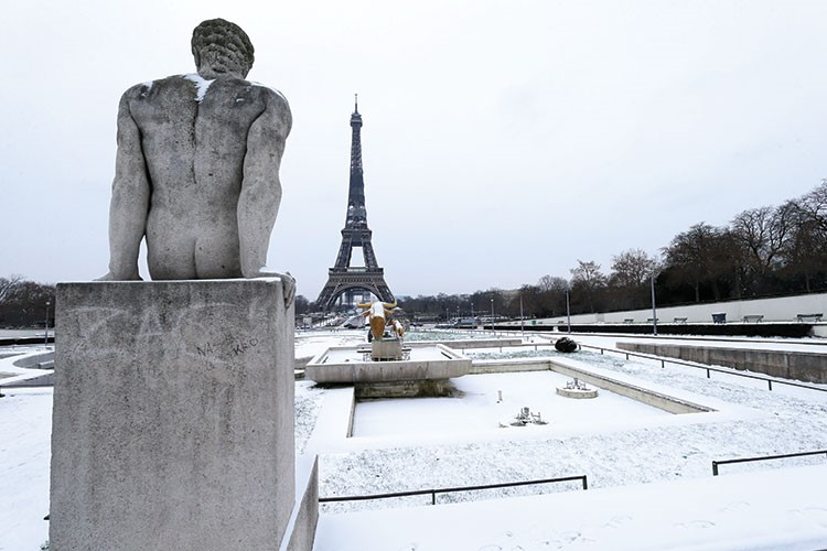 a statue in the snow