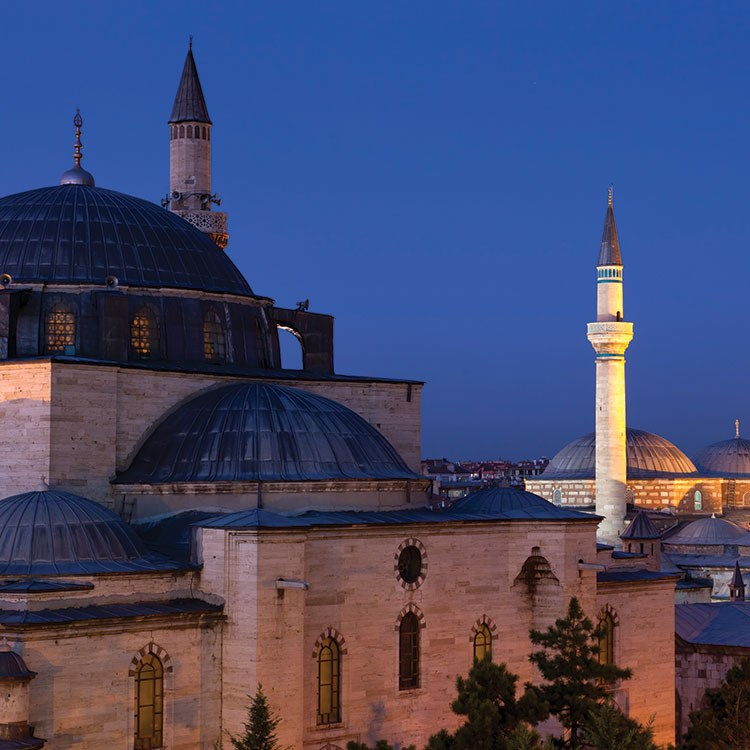 a large building with domed roofs with Mohammad Al-Amin Mosque in the background