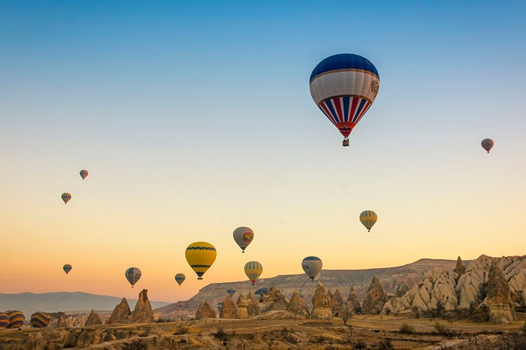 a group of hot air balloons in the sky