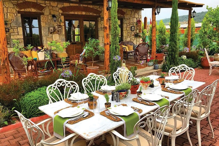 a set of tables and chairs outside