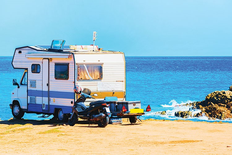 a camper parked on a beach
