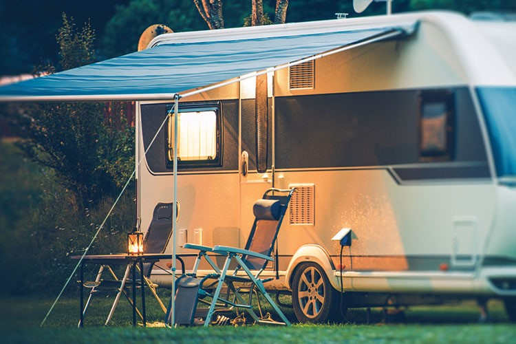 a camper with a canopy