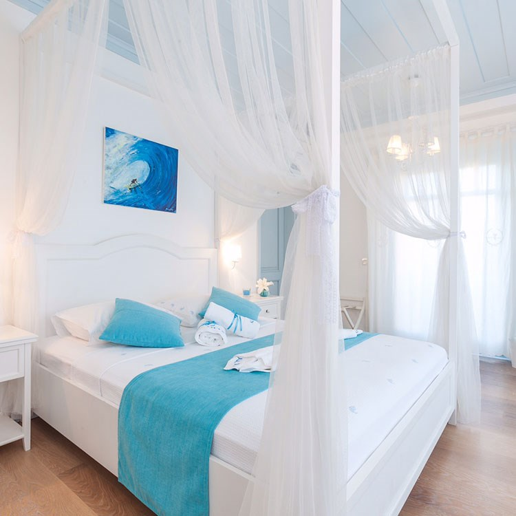 a bed with a blue cover